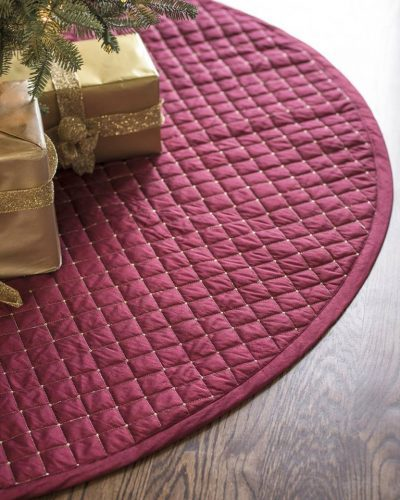 Caption: Our Regency Dupioni Quilted Tree Skirt boasts the vivid hue of cranberries, one of the flavors of the holiday season
