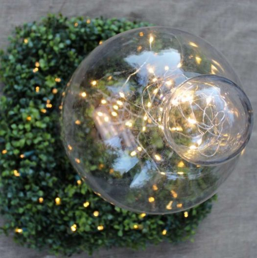 Fill old jars like this glass cloche with fairy string lights for an enchanting display (Photo courtesy of Lehman Lane)