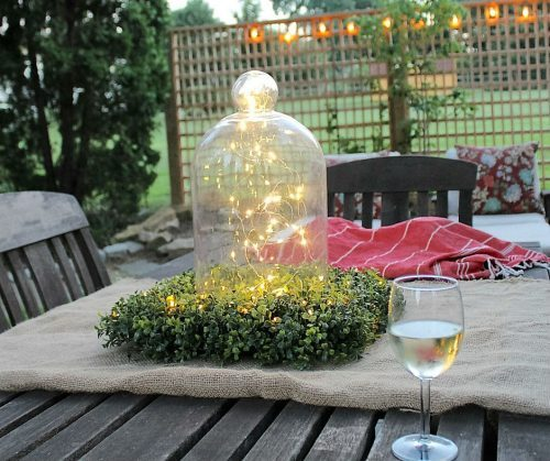 Old glassware, our Outdoor Boxwood Wreath, and Fairy String Lights made an elegant centerpiece(Photo courtesy of Lehman Lane)