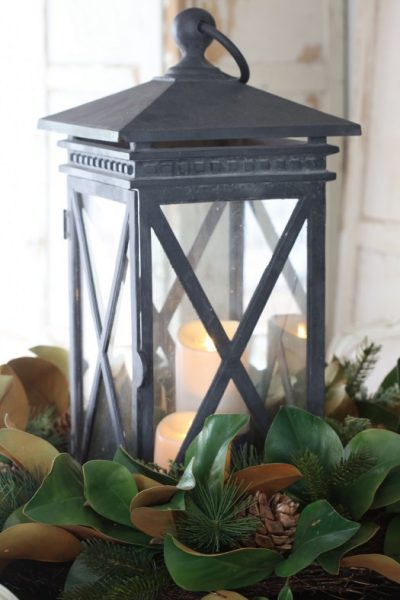 Our Magnolia Wreath used as décor for a lit, traditional lantern
