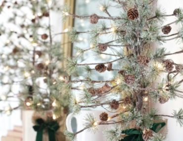 Decorate mantel with tabletop trees like Courtney of French Country Cottage did