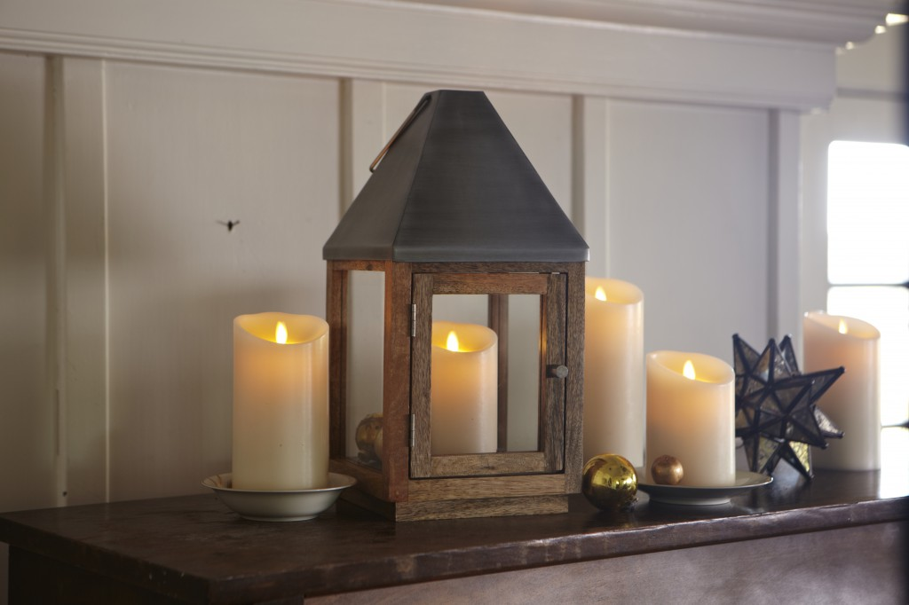 assortment of flameless LED candles on a mantel