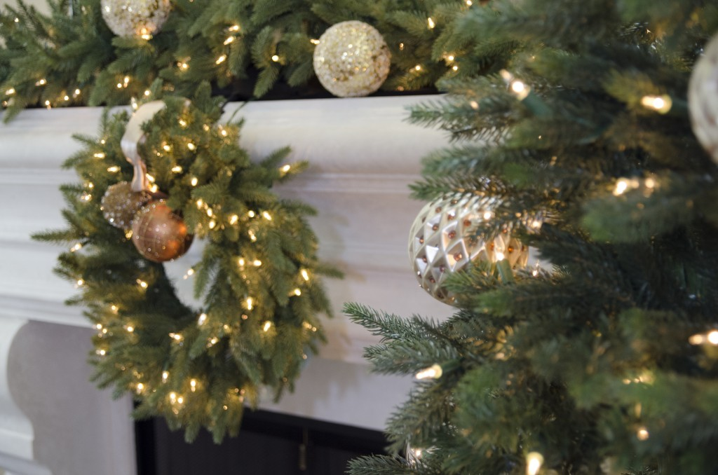 artificial christmas wreath and garland decorated with metallic ornaments