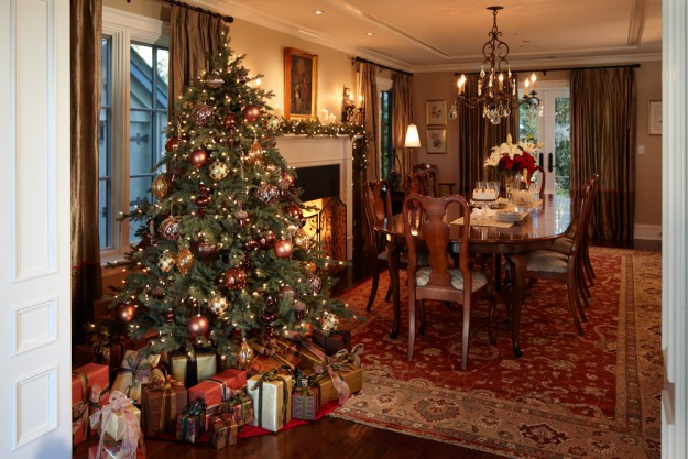 traditionally decorated artificial Christmas tree in a dining room