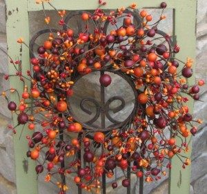 A wreath sprawling with grapevines and faux berries