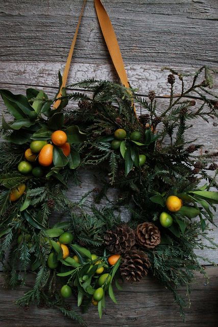 Natural wreath with acorns and citrus fruits