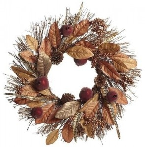 A classic autumn wreath with magnolia leaves, berries, pine cones, pomegranates, and twigs