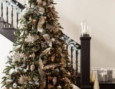 BH Noble Fir decorated in front of a stairwell