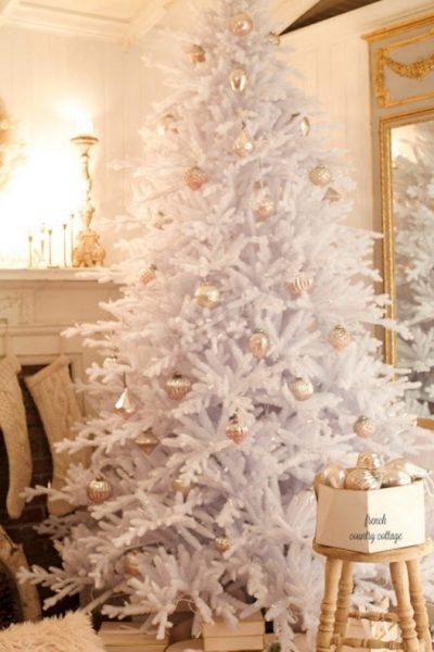 White Christmas tree with metallic ornaments