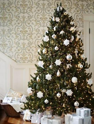 Balsam Hill's Vermont White Spruce decorated with white ornaments to capture the crisp wintry feel of a white Christmas in Vermont
