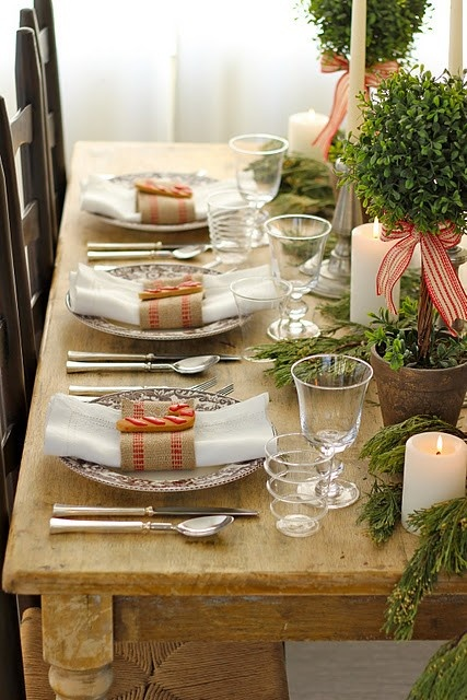 a very rustic space featuring greens, burlap napkin rings and ribbons