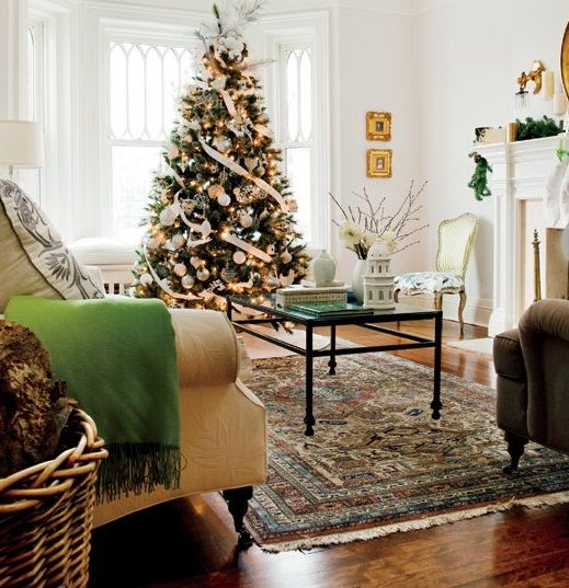 christmas tree beside bay window