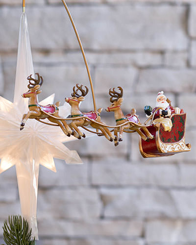 The whimsical Santa's Sleigh Animated Tree Topper