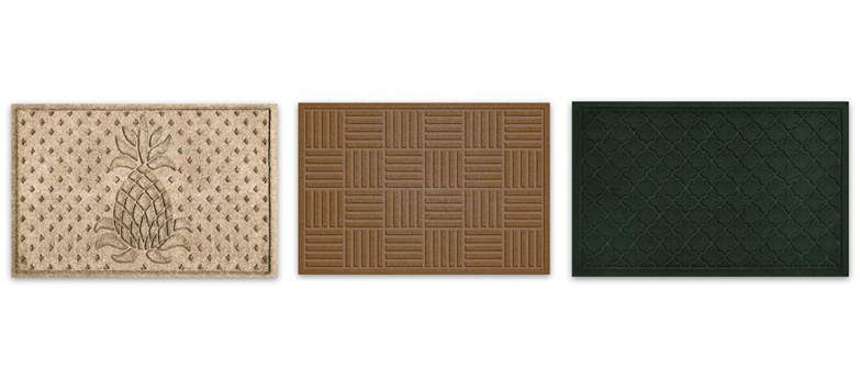 Balsam Hill's Welcome Pineapple, Parisian Parquet, and Drop Crystal floor mats