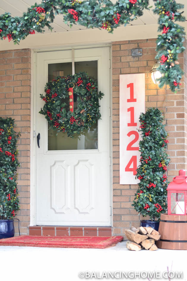 A front porch decorated with Balsam Hill's Bay Laurel with Mixed Berries Topiary