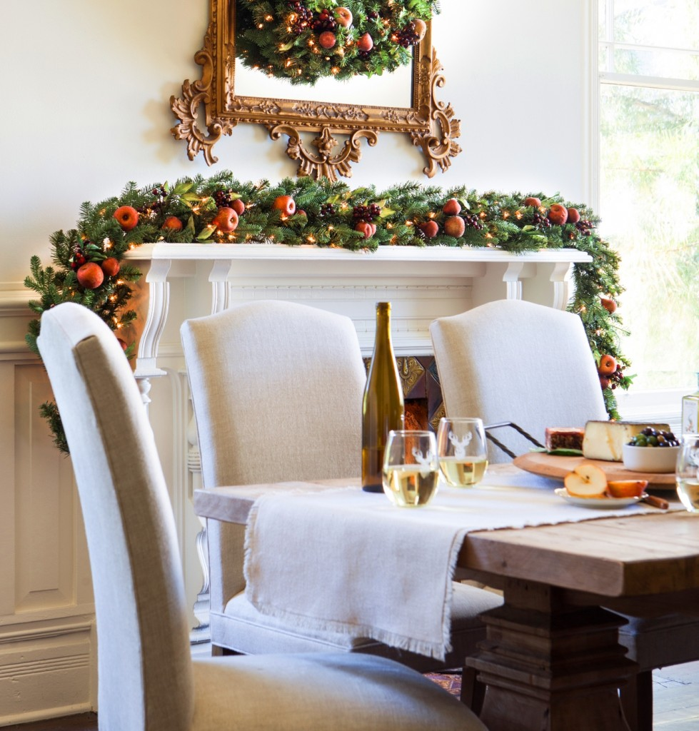 Mantel decorated with autumn-inspired wreath and garland