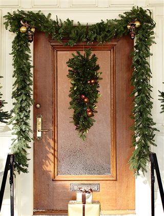 Garlands and a teardrop decorate the front door