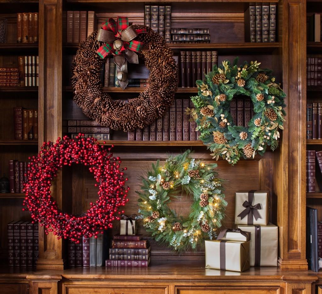 Fall-themed wreaths hang on a shelf