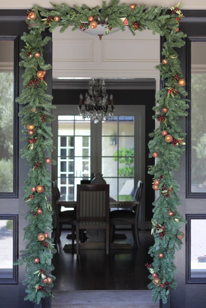Garland Decorating The Front Door
