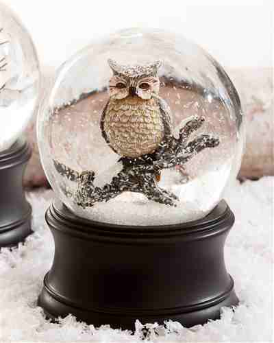 Capture the scenic beauty of a snow-covered forest with the Musical Owl Snow Globe