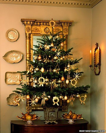 tabletop tree with gold ornaments