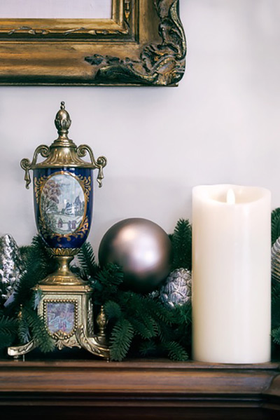 Decorate your mantel with Balsam Hill's stockings, garland, and flameless candles