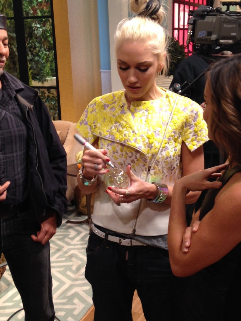 Gwen Stefani signs a glass ornament