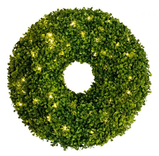 Replace evergreens with spring foliage like Balsam Hill's Outdoor Boxwood Wreaths and Ball Topiaries
