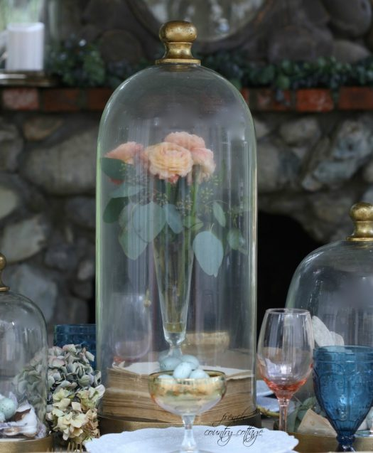Flowers are displayed beautifully inside this elegant glass cloche