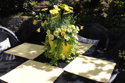 summer flowers and placemats on table