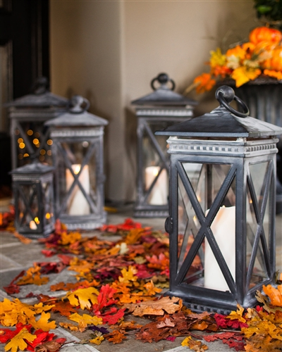 Luminara candles inside our Candela Crossbar Lanterns