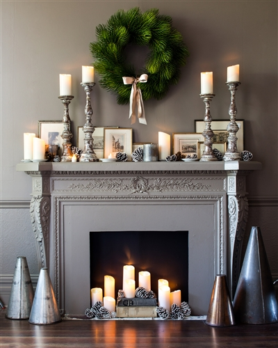 Luminara candles adding dimension to this elegant mantel