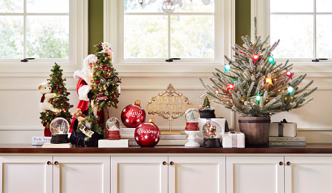Balsam Hill Tabletop Christmas Trees with Christmas ornaments on countertop