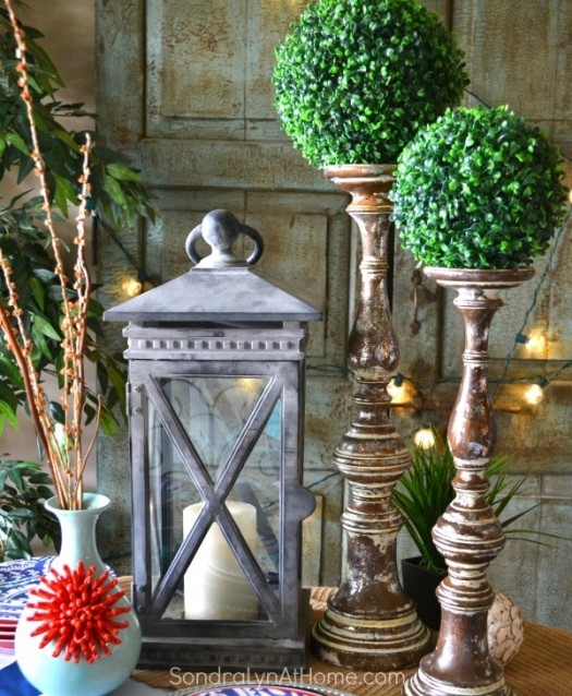Charming tablescape with lantern and flameless candle