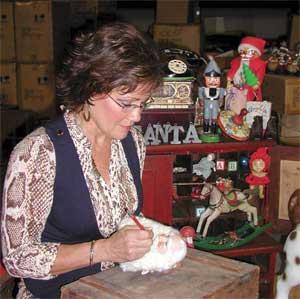 Karen Didion giving Santa some finishing touches