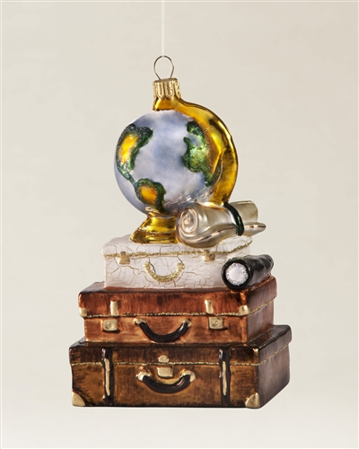 Stacked cases with a globe on top represent the joy of travel