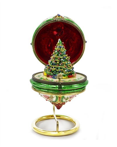Intricately detailed glass egg that opens to reveal miniature tree