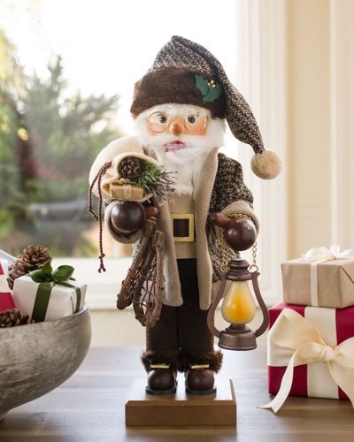 Rustic Santa with lantern and wooden snow shoes