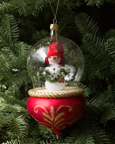 Snowman with cheery red hat in glass ornament