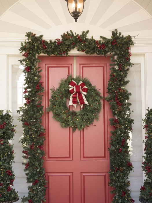 Front door elegantly dressed in Christmas foliage