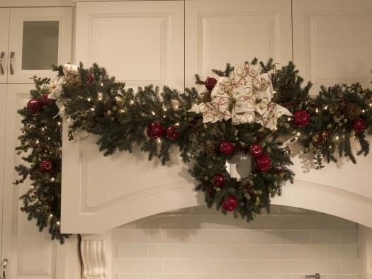 Norway Spruce Holiday Wreath cleverly positioned on kitchen cabinets