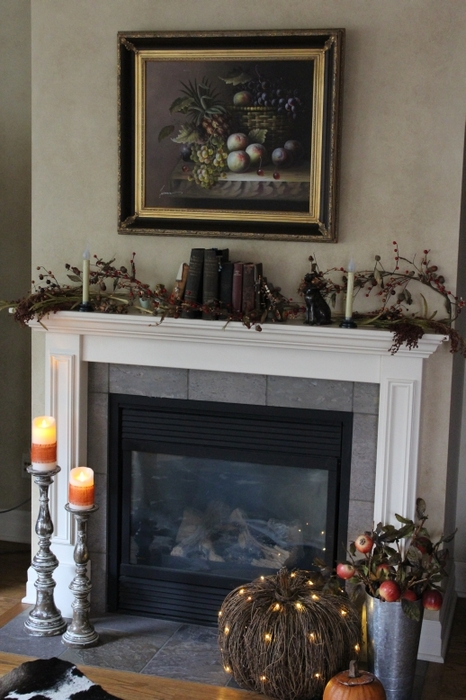 Rustic Halloween mantel with woodsy accents