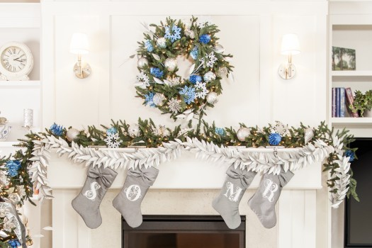 An elegant mantel decked out in a refined color palette of blue, silver and gray