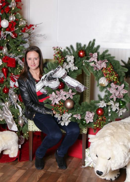 Natasha striking a pose with her wreath