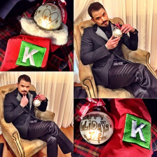Actor Kellan Lutz strikes a pose with his Balsam Hill ornament