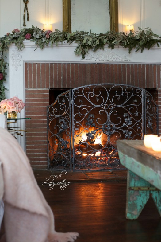 An intricately detailed fireplace screen ensures that the fireplace remains the focal point of the room