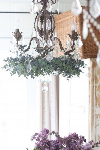 Chandelier embellished with the eucalyptus wreath