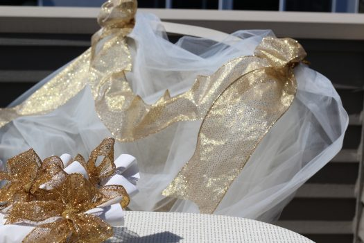 Ribbon and tulle make for an ethereal chair cover