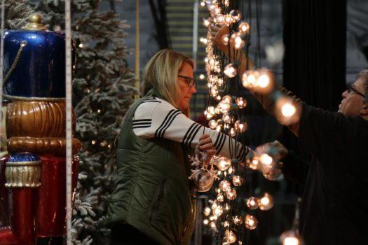 Dagmar decorating the stage using Globe Cafe String Lights
