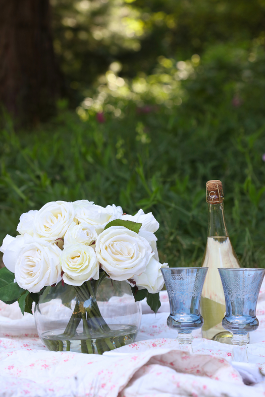 Picnic dressed up with stemware and flowers